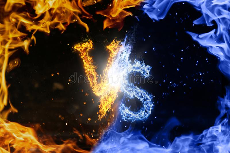Letter VS. Blue versus Yellow fire flames on black stock photos