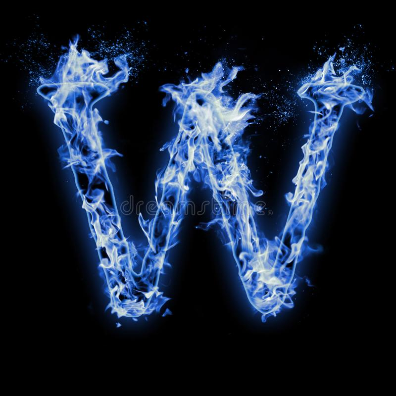 Letter W. Blue fire flames on black stock photography