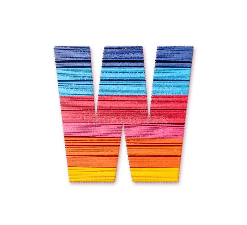 Letter W. Rainbow color paper. royalty free stock photography