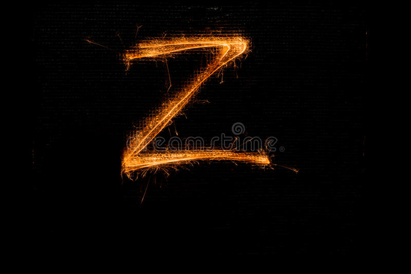 Letter Z made of sparklers on black royalty free stock photos