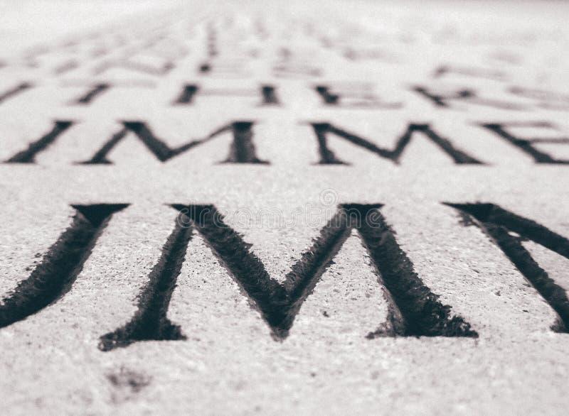 Lettera 'm.' sulla pietra fotografie stock
