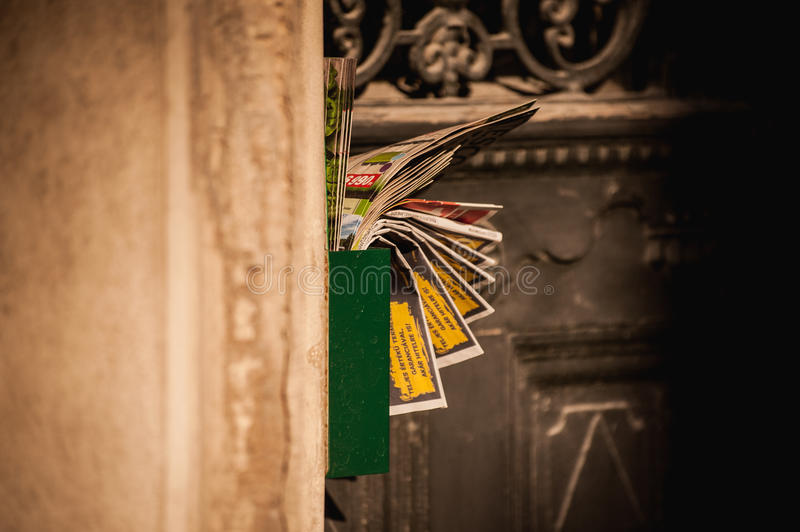 Letterbox jammed full with junk mail royalty free stock image