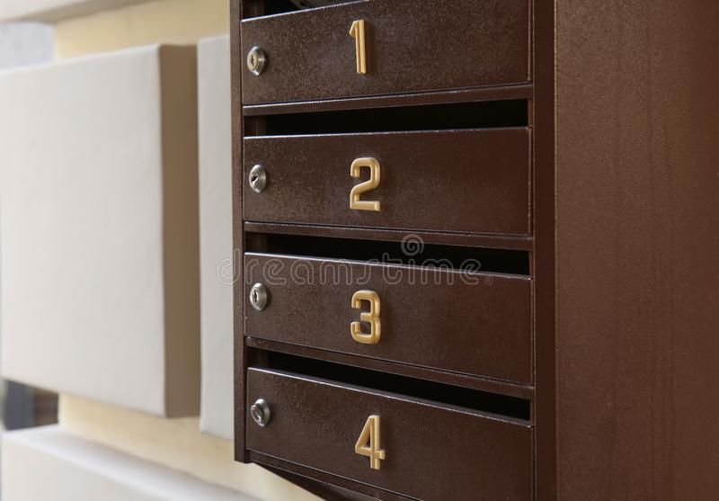 Letterbox mail station on wall of building, closeup stock photos