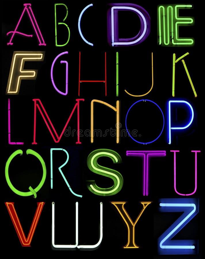 Lettere al neon capitali immagine stock