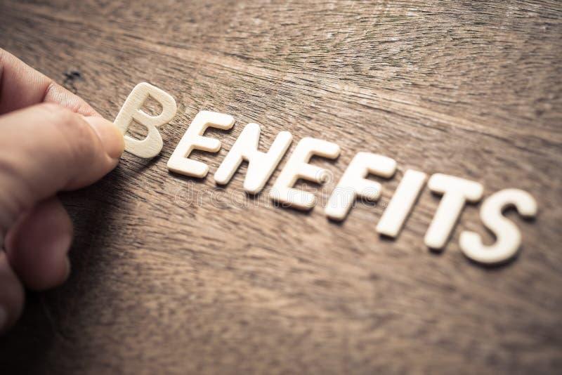 Lettere di legno dei benefici immagini stock libere da diritti