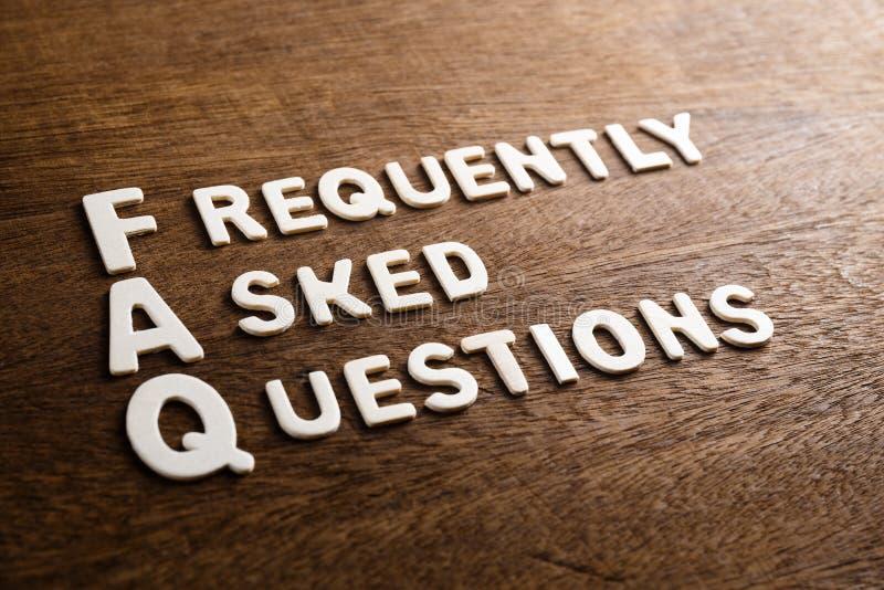 LETTERE di LEGNO dei FAQ fotografie stock libere da diritti
