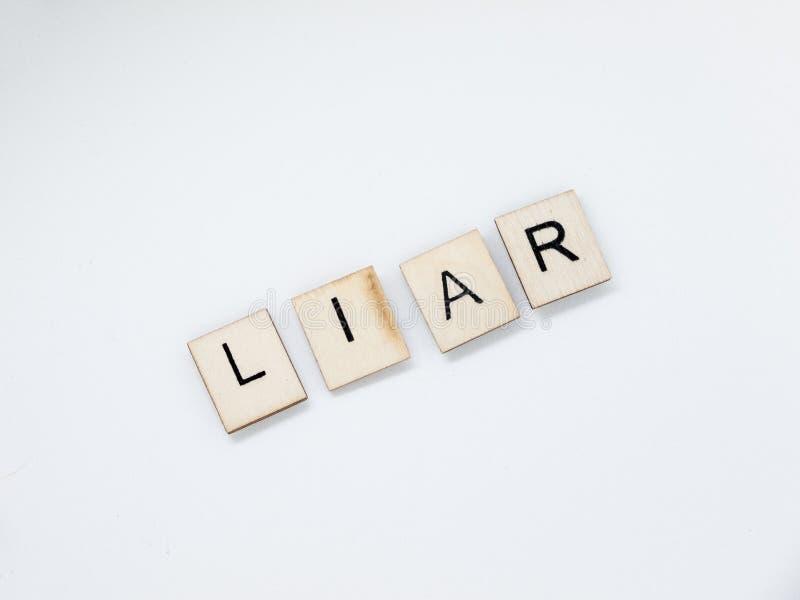 Lettere di legno del bugiardo immagini stock libere da diritti