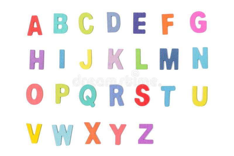 Lettere di legno variopinte di alfabeto isolate su fondo bianco immagine stock libera da diritti