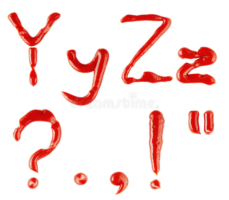 Lettere e segni fatti di ketchup sul backgro bianco fotografia stock