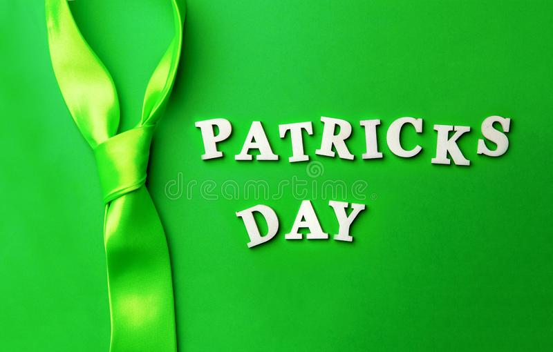 Lettering Patrick`s day, laid out on green background. royalty free stock photography