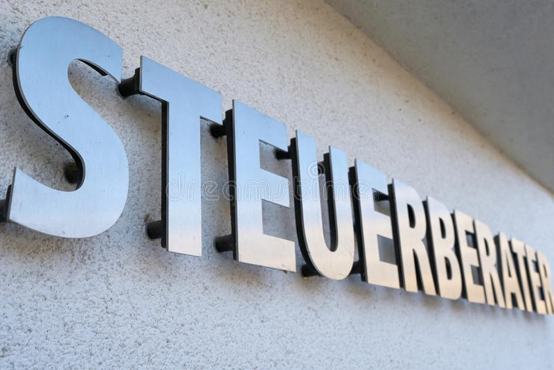 Lettering `Tax Consultant` on the facade of a house. In Germany stock photography