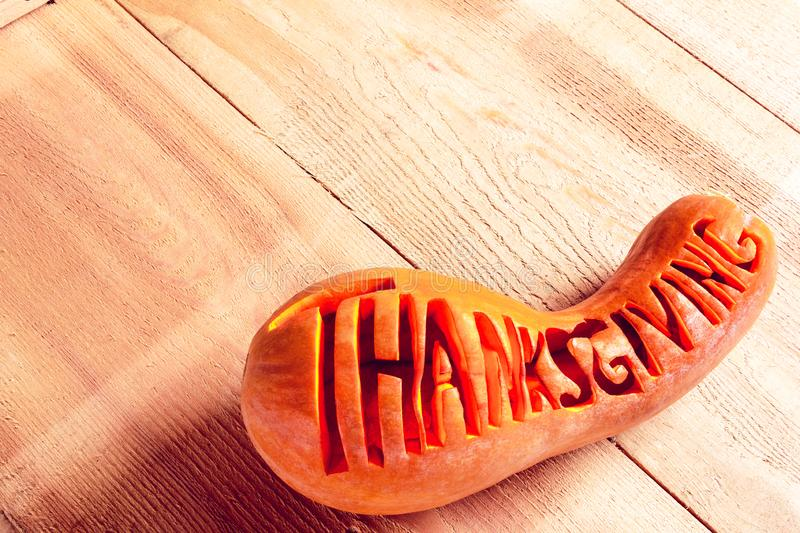 Lettering word `Thanksgiving` on a pumpkin royalty free stock images