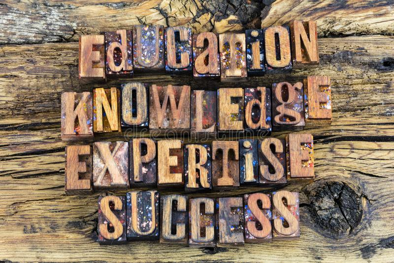 Education knowledge expertise success letters. Letterpress education knowledge expertise success learning concept wood block type text letters rough wood stock photos