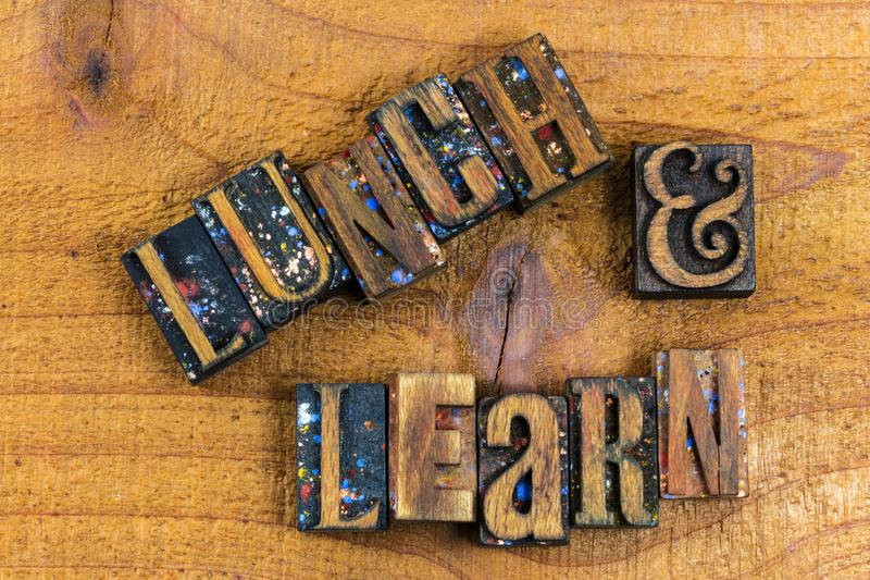 Letterpress lunch and learn sign wooden. Wood message background lunch and learn sign educational learning letters letterpress block typography teaching seminar stock photo