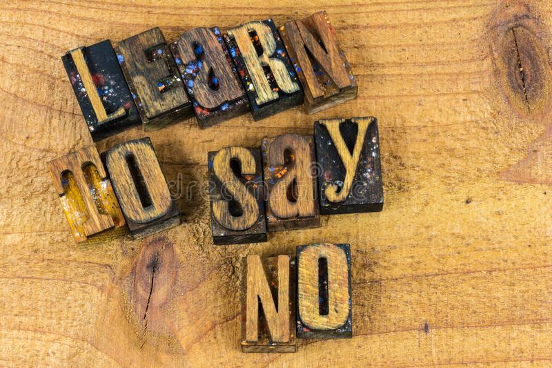 Learn to say no message letterpress. Letterpress type learn to say no message inspiration concept wood letters background typography royalty free stock photo