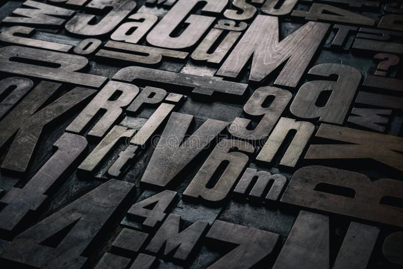 Letterpress wood type printing blocks. Old grungy letterpress wood type printing blocks royalty free stock photography