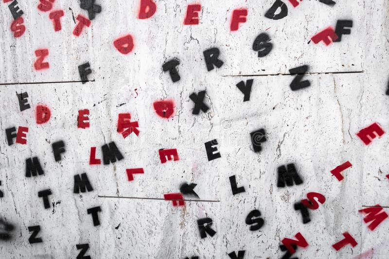 Letters of the alphabet painted on a wall. Ideal for creative concepts and backgrounds royalty free stock image