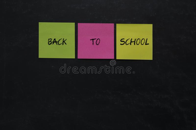 Letters back to school written in colorful postit, royalty free stock image