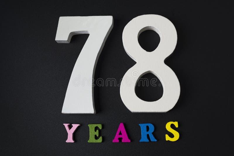 Letters en getallen achtenzeventig jaar oud op een zwarte achtergrond stock afbeelding