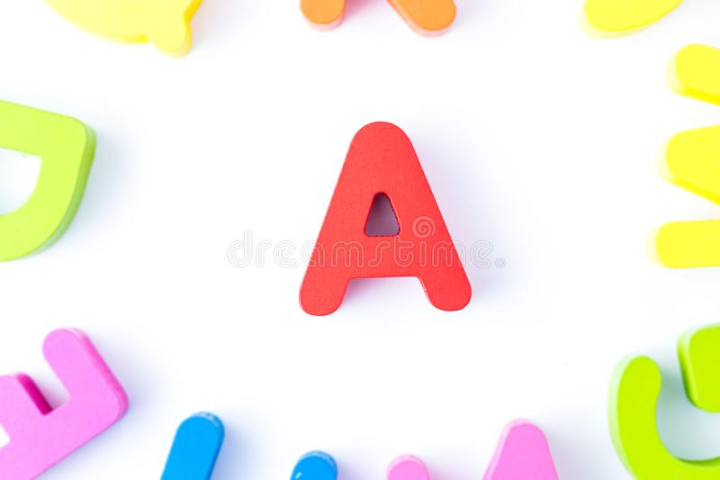 A letters in English. Made from wood bright colors royalty free stock photography