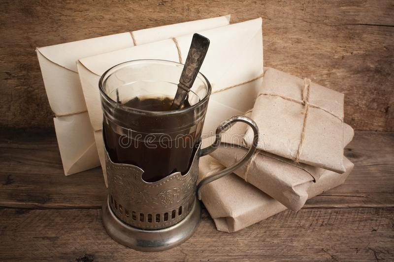 Letters and a glass of tea. Still life royalty free stock photography