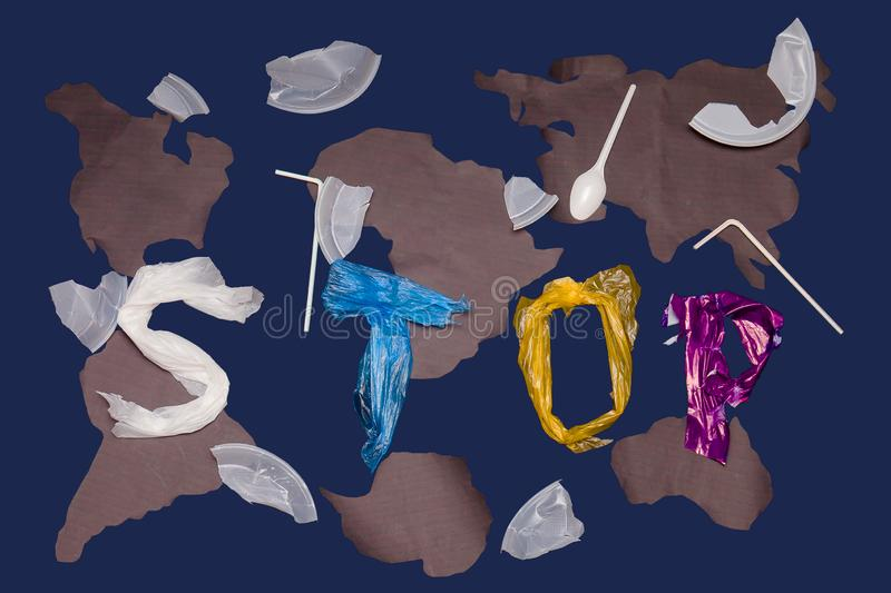 Letters located on a blue background. Stop the poison of toxic decomposition of the plastic. Letters arranged in a blue background, isolate. Stop the poison of stock image