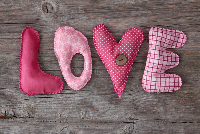 Letters love. On wooden background stock images