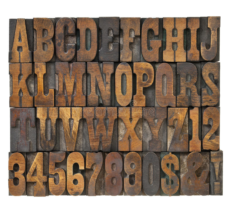 Letters and numbers abstract in vintage type. Letters and numbers abstract in vintage letterpress wood type - alphabet in French clarendon typeset royalty free stock photos