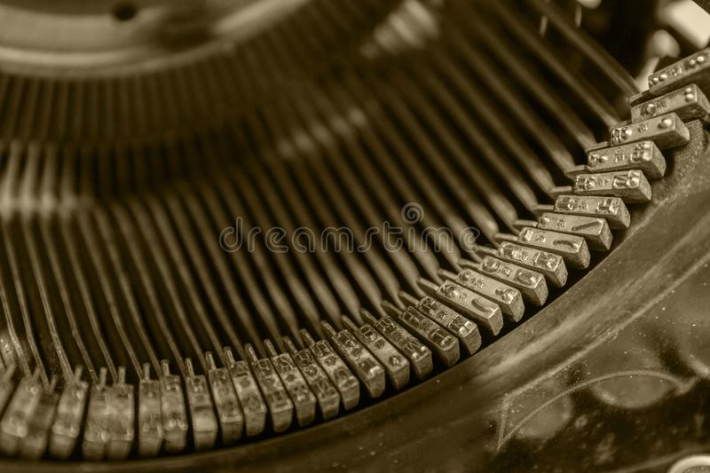 Letters of the old typewriter photo close up vintage tinted stock photos