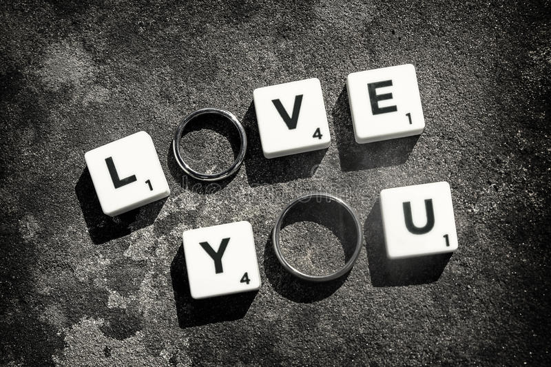 Letters and Rings. Board game letters and wedding rings spell out that special message on a wedding day. Unless otherwise stated, all imagery by Gordon Elias of stock photo
