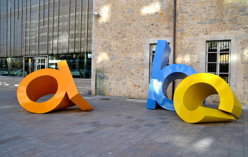 Letters sculpture named Les lletres toves in Girona, Spain stock photography