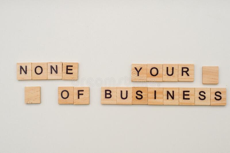 Letters on wooden blocks. None of your business concept. Scrabble. Business game royalty free stock images