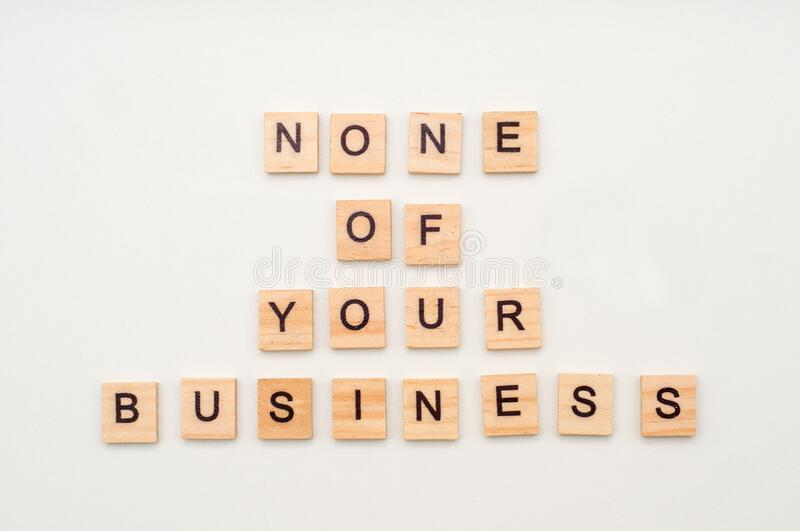 Letters on wooden blocks. None of your business concept. Scrabble. Business game stock image
