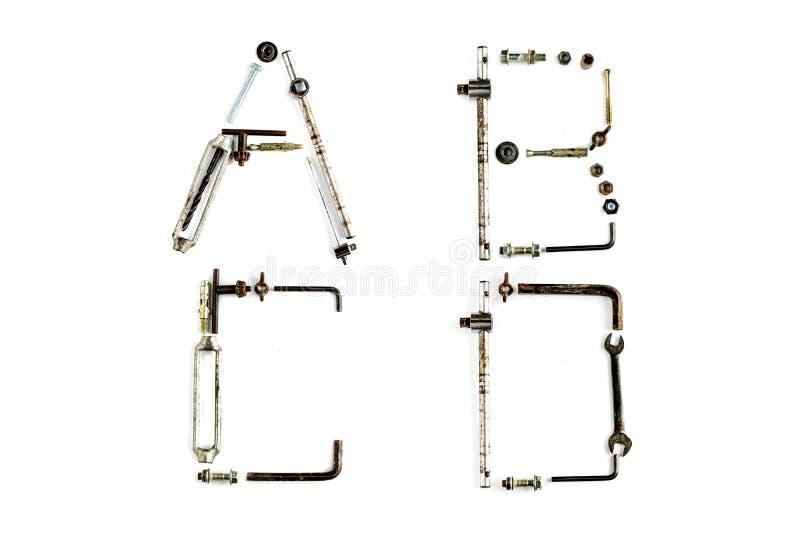 Lettre industrielle A, B, C, D d'alphabet en métal d'isolement images libres de droits