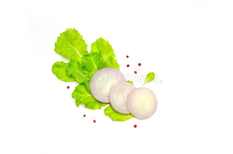 Lettuce and onion rounds and bell pepper on white background. Selective focus stock photos