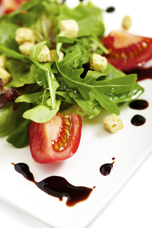 Lettuce plate. Fresh lettuce salad plate garnished with balsamic vinegar royalty free stock photo