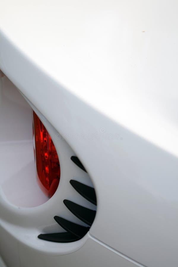 Leuchtedetail der hinteren Bremse über britisches Sportauto stockbild