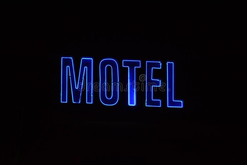 Leuchtreklame mit dem Wort Motel stockbild