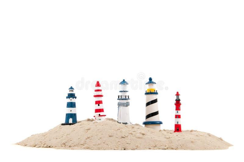 Leuchttürme am Strand lizenzfreie stockfotos