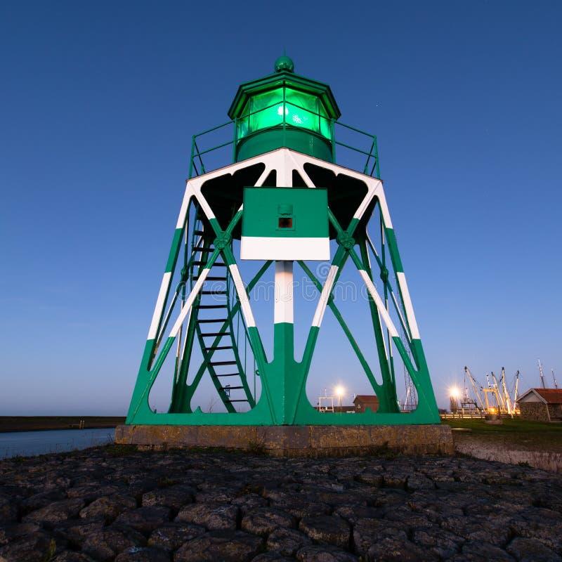 Leuchtturm grünes Holland lizenzfreie stockbilder