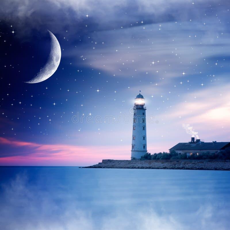 Leuchtturm nachts stockbild