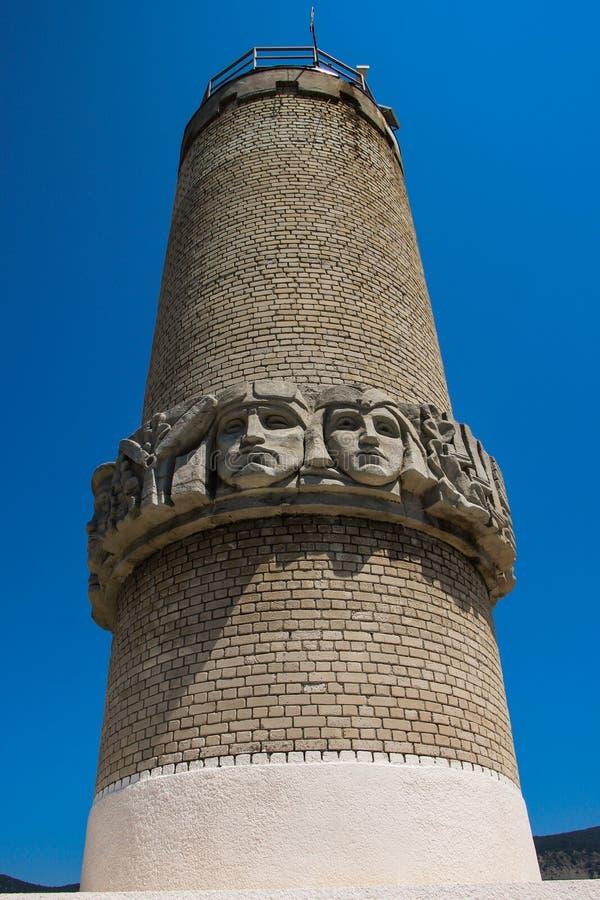 Leuchtturm und Gesicht stockbild