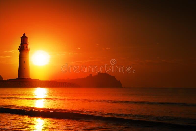 Leuchtturmsonnenaufgang stockbilder