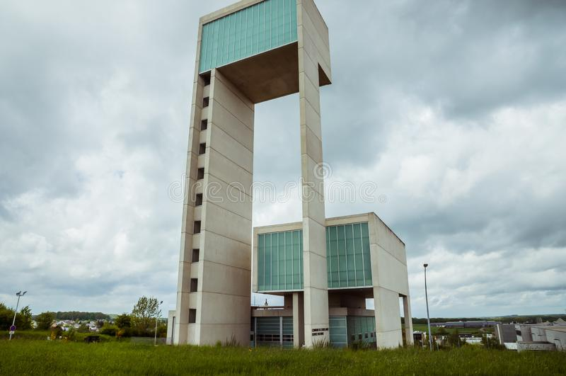 Leudelange, Luxembourg - May 5 2013 : Water tower with it's modern design in concrete and fiberglass, also a fire department. Of the city royalty free stock image