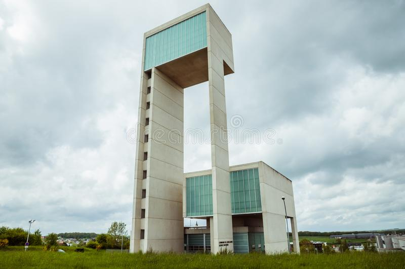 Leudelange, Luxembourg - May 5 2013 : Water tower with it's modern design in concrete and fiberglass, also a fire department. Of the city stock photography