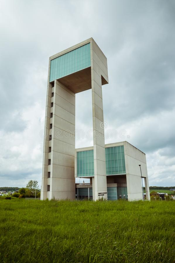 Leudelange, Luxembourg - May 5 2013 : Water tower with it's modern design in concrete and fiberglass, also a fire department. Of the city stock image