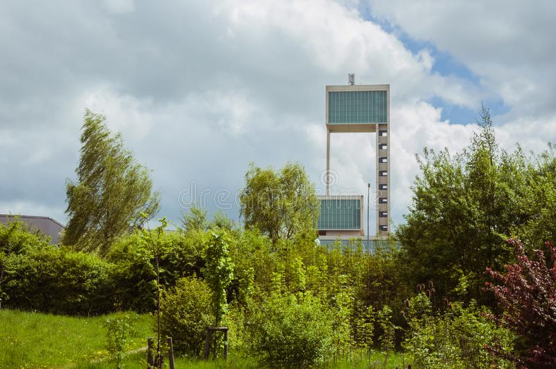 Leudelange, Luxembourg - May 5 2013 : Water tower with it's modern design in concrete and fiberglass, also a fire department. Of the city stock images