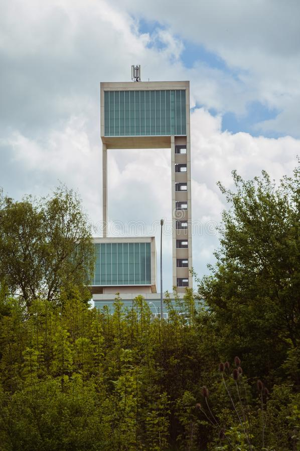 Leudelange, Luxembourg - May 5 2013 : Water tower with it's modern design in concrete and fiberglass, also a fire department. Of the city royalty free stock images