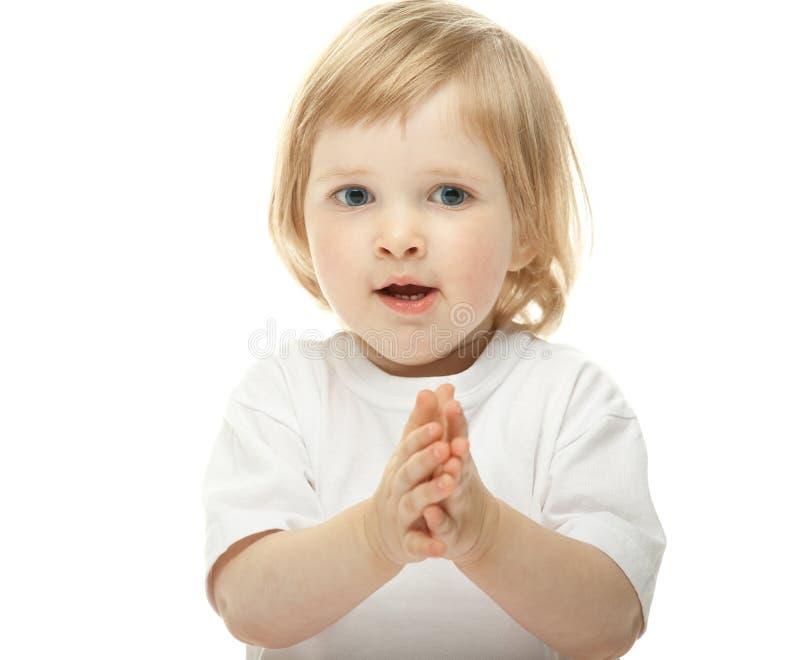 Leuk babymeisje dat haar handen slaat stock afbeeldingen