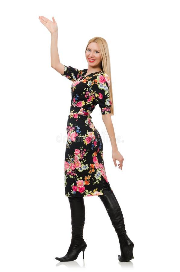 Leuk blondemeisje in bloemendiekleding op wordt geïsoleerd stock foto's
